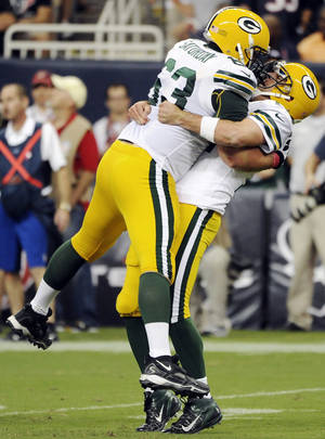 Photo -   Green Bay Packers quarterback Aaron Rodgers, right, celebrates a touchdown with center with Jeff Saturday (63) against the Houston Texans during the second quarter of an NFL football game, Sunday, Oct. 14, 2012, in Houston. (AP Photo/Dave Einsel)
