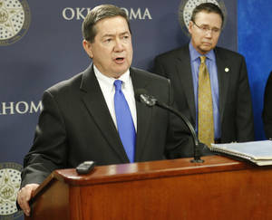 photo - Former Oklahoma Attorney General Drew Edmondson, left, joined Oklahoma City Police Chief Bill Citty and other members of the Oklahoma Justice Commission on Friday at the state Capitol to announce the results of a two-year wrongful convictions review. Photo By Steve Gooch, The Oklahoman