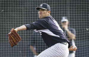 Photo - New York Yankees starting pitcher Masahiro Tanaka throws a pitch during spring training baseball practice Friday, Feb. 21, 2014, in Tampa, Fla. (AP Photo/Charlie Neibergall)