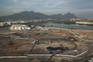 Photo - FILE - This May 13, 2014 file photo shows an aerial view, shot through an airplane window, of Olympic Park under construction in Rio de Janeiro, Brazil. Rio Olympic organizers, criticized over delays with the games barely two years away, announced through a statement on Wednesday, May 14, 2014 that several of the permanent venues are ready. (AP Photo/Felipe Dana, File)