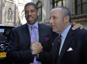 Photo - Sacramento Mayor Kevin Johnson, left, and California state Sen. Darrell Steinberg arrive for the  NBA owners meetings regarding the the possible relocation of the Sacramento Kings  team to Seattle, in New York, Wednesday, April 3, 2013. Hedge fund manager Chris Hansen and Microsoft Chief Executive Steve Ballmer have agreed to buy a majority stake in the Kings from the Maloof family for $341 million, but the deal needs league approval. (AP Photo/Richard Drew)