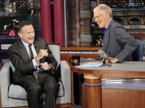 "Photo - In this Wednesday, Sept. 25, 2013 photo provided by CBS, actor Robin Williams, left, joins host David Letterman on the set of the ""Late Show with David Letterman,"" in New York. CBS says Letterman has signed a contract extension to remain host of the ""Late Show"" into 2015. (AP Photo/John Paul Filo) MANDATORY CREDIT; NO ARCHIVE; NO SALES; NORTH AMERICAN USE ONLY"