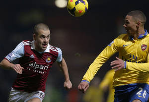 Photo - FILE - This is a Thursday, Dec. 26, 2013 file photo of West Ham United's Joe Cole, left, as he competes with Arsenal's Kieran Gibbs during their English Premier League soccer match at Upton Park, London. Joe Cole signed  for the English Premier League team Aston Villa on Tuesday June 10, 2014.(AP Photo/Sang Tan, File)