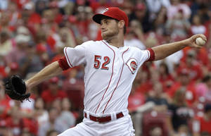 Photo - Cincinnati Reds starting pitcher Tony Cingrani throws to a San Francisco Giants batter in the first inning of a baseball game, Wednesday, July 3, 2013, in Cincinnati. (AP Photo/Al Behrman)