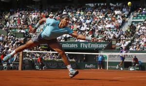 Photo - Spain's Rafael Nadal returns the ball during the third round match of the French Open tennis tournament against Argentina's Leonardo Mayer at the Roland Garros stadium, in Paris, France, Saturday, May 31, 2014. (AP Photo/Michel Euler)
