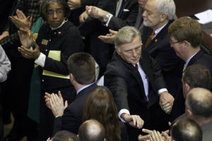 photo - Arkansas Gov. Mike Beebe, center right, is greeted by legislators in the House chamber at the Arkansas state Capitol in Little Rock, Ark., after he delivered his State of the State address Tuesday, Jan. 15, 2013. (AP Photo/Danny Johnston)