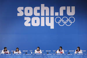 Photo - A delegation from the 2018 Pyeongchang Olympic Winter Games attend a press conference during the 2014 Winter Olympics, Saturday, Feb. 22, 2014, in Sochi, Russia. (AP Photo/Bernat Armangue)