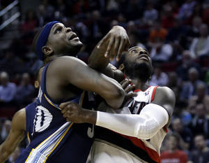 Photo - Memphis Grizzlies forward Zach Randolph, left, and Portland Trail Blazers forward J.J. Hickson battle for position under the basket for a rebound during the second half of an NBA basketball game in Portland, Ore., Wednesday, April 3, 2013.  Randolph scored 17 points and pulled in 8 rebounds as Memphis won 94-76.(AP Photo/Don Ryan)