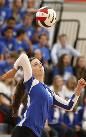 Photo - GIRLS HIGH SCHOOL VOLLEYBALL: Mount St. Mary's Sarah Jekel serves the ball during the first round of the Class 4A state volleyball tournament between Mt. St. Mary's High School and Catoosa High School at Westmoore High School in Moore, OK, Friday, October 11, 2013,  Photo by Paul Hellstern, The Oklahoman
