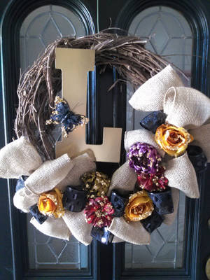 Photo - This fall wreath created by Lezley Lynch of Lezley Lynch Designs in Edmond, features less traditional fall colors. This was one of Lynch's many pins on her Pinterest boards. Photo provided. <strong></strong>