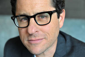 Photo - FILE - In a Saturday, May 6, 2013 file photo, JJ Abrams poses for a portrait session at the Corinthia Hotel in London. JJ Abrams directed the latest release of the Star Trek film franchise: Into Darkness. (Photo by Richard Chambury/Invision/AP, File)