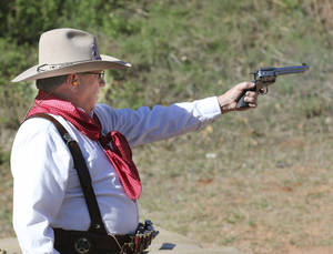 "Photo - "" Fat Chance Buck O"" Eddie Fritts, O'Fallon, Missouri competes in The Land Run, cowboy action shooting competition at the  Oklahoma City Gun Club, Friday April 25, 2014. Photo By Steve Gooch, The Oklahoman"