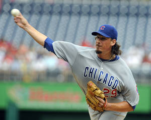 Photo -   Chicago Cubs' starting pitcher Jeff Samardzija deliver to the Washington Nationals during their baseball game at Nationals Park, Monday, Sept. 3, 2012, in Washington. (AP Photo/Richard Lipski)