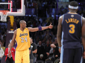 Photo -   Los Angeles Lakers' Kobe Bryant celebrates their win a NBA first-round playoff basketball game in Los Angeles, Tuesday, May 1, 2012. The Lakers won 104-100. (AP Photo/Chris Carlson)