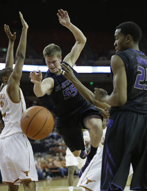Photo - Kansas State's Will Spradling (55) loses control of the ball during the second half of a NCAA college basketball game against Texas, Tuesday,  Jan. 21, 2014, in Austin, Texas. Texas won 67-64. (AP Photo/Eric Gay)
