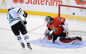 Photo - Dallas Stars' Jamie Benn scores the game-winning shootout goal against Ottawa Senators' Robin Lehner during NHL action in Ottawa, Sunday, Nov. 3, 2013. Dallas defeated Ottawa 4-3.  (AP Photo/The Canadian Press, Sean Kilpatrick)