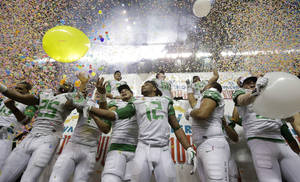Photo - Oregon players celebrate the team's win over Texas in the Valero Alamo Bowl NCAA college football game, Monday, Dec. 30, 2013, in San Antonio. Oregon won 30-7. (AP Photo/Eric Gay)
