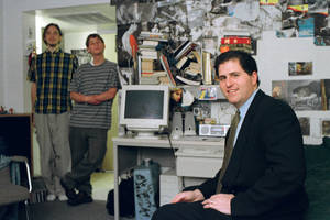 photo - FILE - In this Friday, Feb. 26, 1999, file photo, Michael Dell, foreground, sits in the dorm room at the University of Texas in Austin, Texas, where he launched his enterprise as a college freshman. Michael Dell was the Mark Zuckerberg of his time. Hailed as a young genius, he created the inexpensive, made-to-order personal computer in his dorm room and peddled it to the masses. (AP Photo/Harry Cabluck, File)
