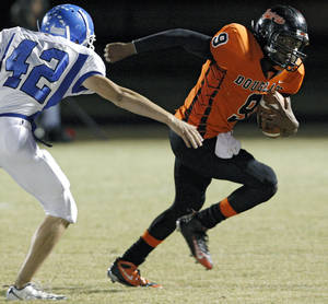 photo - Glenpool's Cody Davis tries to catch Douglass' Marcus Caddell during their game at Moses F. Miller Stadium at Douglass High School in Oklahoma City on Friday, Oct. 29, 2010. Photo by John Clanton, The Oklahoman