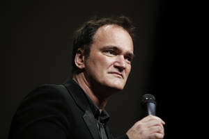 "Photo - FILE - In this Oct. 18, 2013 file photo, director Quentin Tarantino  delivers a speech before receiving the Lumiere Award during the 5th edition of the Lumiere Festival, in Lyon, central France. Tarantino sued Gawker Media LLC on Monday, Jan. 27, 2014, in Los Angeles for copyright infringement over the site's posting of a story that linked to a leaked copy of his script for a planned film called ""The Hateful Eight."" (AP Photo/Laurent Cipriani, File)"