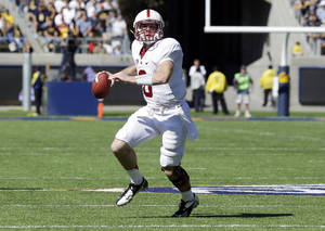 Photo -   In this Oct. 20, 2012, photo, Stanford quarterback Kevin Hogan looks to pass during an NCAA college football game against California in Berkeley, Calif. Hogan is expected to make his first start against No. 13 Oregon State on Saturday, Nov. 10, in what is essentially a Pac-12 North semifinal. (AP Photo/Marcio Jose Sanchez, File)