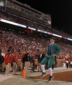Photo - CELEBRATION: The Notre Dame mascot celebrates a touchdown during the college football game between the University of Oklahoma Sooners (OU) and the Notre Dame Fighting Irish at the Gaylord Family-Oklahoma Memorial Stadium on Saturday, Oct. 27, 2012, in Norman, Okla. Photo by Chris Landsberger, The Oklahoman