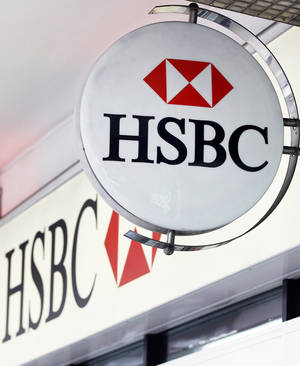 Photo - The logo is seen on a branch of HSBC bank in London. AP Photo