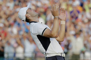 Photo - Martin Kaymer, of Germany celebrates after winning the U.S. Open golf tournament in Pinehurst, N.C., Sunday, June 15, 2014.  (AP Photo/Eric Gay)