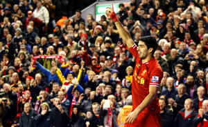 Photo - Liverpool's Luis Suarez celebrates scoring against Hull City during the English Premier League soccer match at Anfield, Liverpool, England, Wednesday Jan. 1, 2014. (AP Photo/PA, Peter Byrne) UNITED KINGDOM OUT  NO SALES  NO ARCHIVE
