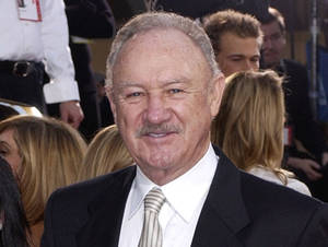 Photo -   FILE - This Jan. 19, 2003 file photo shows actor Gene Hackman at the 60th Annual Golden Globe Awards in Beverly Hills, Calif. A New Mexico police report says Gene Hackman had given clothes, money and rides to a homeless man he slapped this week after the man became aggressive toward the Oscar-winning actor and his wife. The Santa Fe New Mexican reports Hackman and his wife told officers they had helped 63-year-old Bruce Becker for several years. The Santa Fe police report says Hackman rebuffed Becker when he approached them Tuesday, Oct. 30, 2012, and told him to get a job. Police say Hackman acted in self-defense and no charges have been filed. (AP Photo/Mark J. Terrill, file)