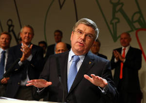Photo - Thomas Bach, of Germany, speaks after being elected the new IOC president during the 125th IOC session in Buenos Aires, Argentina,  Tuesday, Sept. 10, 2013. (AP Photo/Alexander Hassenstein, Pool)