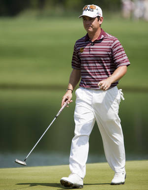 Photo -   Louis Oosthuizen walks off the green of the second hole during the third round of the Houston Open golf tournament on Saturday, March 31, 2012, in Humble, Texas. (AP Photo/Eric Kayne)