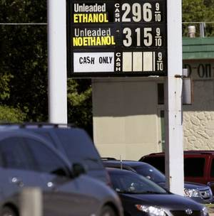 photo - A gas station at 63rd and Merididan advertises gas prices lower than $3 per gallon in Oklahoma City on Monday, September 26, 2011. Photo by John Clanton, The Oklahoman ORG XMIT: KOD