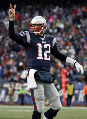 Photo - New England Patriots quarterback Tom Brady signals for his team to attempt a two-point conversion against the Cleveland Browns in the third quarter of an NFL football game on Sunday, Dec. 8, 2013, in Foxborough, Mass. The Patriots won 27-26. (AP Photo/Elise Amendola)