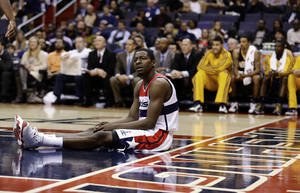Photo -   Washington Wizards guard Jordan Crawford pauses on the court during the first half of an NBA basketball game against the Indiana Pacers on Monday, Nov. 19, 2012, in Washington. The Pacers won 96-89. (AP Photo/Alex Brandon)