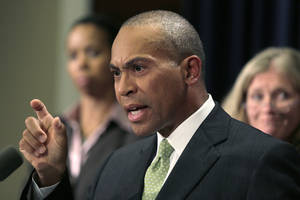 Photo -   Mass. Gov. Deval Patrick gestures during a news conference regarding the Massachusetts pharmacy responsible for the meningitis outbreak during a news conference at the Statehouse in Boston, Tuesday, Oct. 23, 2012. The outbreak of meningitis, an inflammation of the lining of the brain and spinal cord, has sickened nearly 300 people, including 23 who died, in more than a dozen states. (AP Photo/Charles Krupa)