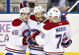 Photo - Montreal Canadians Michael Bournival (49), Brandon Prust (8) and Andrei Markov (79) celebrate a goal against the Edmonton Oilers during second-period NHL hockey game action in Edmonton, Alberta, Thursday, Oct. 10, 2013. (AP {Photo/The Canadian Press, Jason Franson)