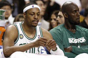 Photo - Boston Celtics' Paul Pierce, left, and Kevin Garnett sit on the bench during the fourth quarter of their 90-76 loss to the New York Knicks in Game 3 of a first round NBA basketball playoff series in Boston Friday, April 26, 2013. (AP Photo/Winslow Townson)