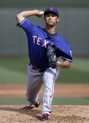 Photo - Texas Rangers' Yu Darvish (11), of Japan, delivers to the Kansas City Royals in the second inning of an exhibition baseball game on Thursday Feb. 27, 2014, in Surprise, Ariz. (AP Photo/Tony Gutierrez)