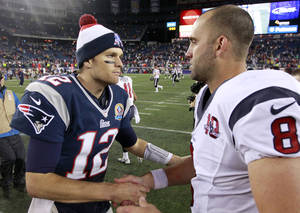Photo - New England Patriots quarterback Tom Brady (12) shakes hands with Houston Texans quarterback Matt Schaub (8) following an NFL football game in Foxborough, Mass., Monday, Dec. 10, 2012. The Patriots won 42-14. (AP Photo/Steven Senne)