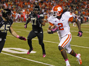 Photo -   Clemson's Sammy Watkins (2) runs past Wake Forest's Riley Haynes (45) and A.J. Marshall (17) during the first half of an NCAA college football game in Winston-Salem, N.C., Thursday, Oct. 25, 2012. (AP Photo/Chuck Burton)