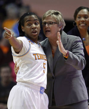 Photo - Tennessee coach Holly Warlick talks with guard Ariel Massengale during the first half of an NCAA college basketball game against LSU on Thursday, Jan. 2, 2014, in Knoxville, Tenn. LSU won 80-77. (AP Photo/Wade Payne)