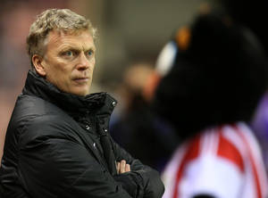 Photo - Manchester United's manager David Moyes looks on ahead of their English League Cup semifinal first leg soccer match against Sunderland at the Stadium of Light, Sunderland, England, Tuesday, Jan. 7, 2014. (AP Photo/Scott Heppell)