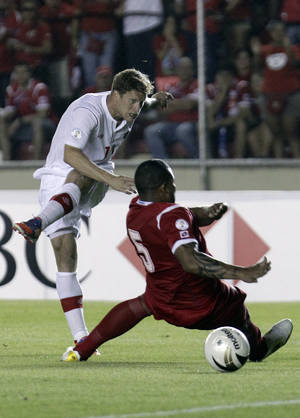 Photo -   Panama's Roman Torres, right, and Canada's Marcel de Jong fight for the ball during a 2014 World Cup qualifying soccer match in Panama City, Tuesday, Sept. 11, 2012. (AP Photo/Arnulfo Franco)
