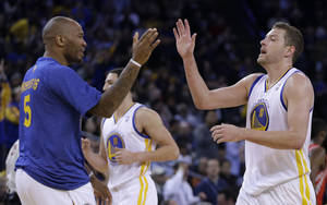 Photo - Golden State Warriors' David Lee, right, is congratulated by Marreese Speights (5) during a timeout in the second half of an NBA basketball game against the Houston Rockets Thursday, Feb. 20, 2014, in Oakland, Calif. (AP Photo/Ben Margot)