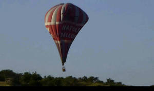 This image from video provided by E. Wayne Ross shows an Anatolian Balloons Company hot air balloon crashing near Göreme National Park and the Rock Sites of Cappadocia in central Turkey, Monday May 20 2013. Two hot air balloons collided in mid-air during a sightseeing tour of volcanic rock formations in Turkey on Monday, causing one of them to crash to the ground, officials said. One Brazilian tourist was killed while 24 other people on board were injured. (AP Photo/E. Wayne Ross)