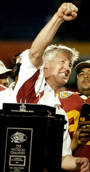 Photo - Miami, Florida - January 4, 2005. University of Oklahoma (OU) Sooners vs. University of Southern California (USC) Trojans college football in the Orange Bowl BCS National Championship at Pro Player Stadium. Pete Carroll celebrates the BCS National Championship and Orange Bowl victory.  By Steve Sisney/The Oklahoman