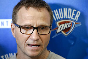 Photo - Coach Scott Brooks speaks during the Oklahoma City Thunder media availability at the Thunder practice facility in Oklahoma City, Okla. on Monday, May 12, 2014.   Photo by Chris Landsberger, The Oklahoman