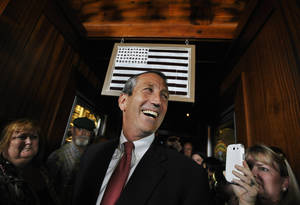 Photo - Former South Carolina Gov. Mark Sanford arrives to give his victory speech on Tuesday, May 7, 2013, in Mt. Pleasant, S.C. Sanford won back his old congressional seat in the state's 1st District in a special election. (AP Photo/Rainier Ehrhardt)