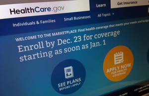 Photo - This Dec. 20, 2013, image shows part of the HealthCare.gov website in Washington, that notes to enroll by Dec. 23 for coverage starting as soon as Jan. 1, 2014. Policies will soon take effect in new health insurance markets that have been trying to enroll customers. (AP Photo/Jon Elswick)